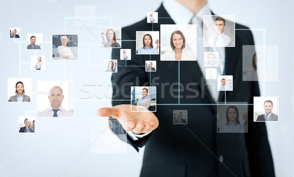 close up of man hand showing business contacts Stock photo © dolgachov