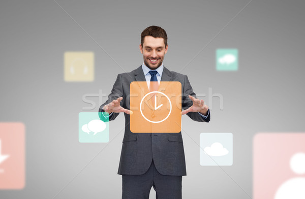 businessman working with clock icon projection Stock photo © dolgachov
