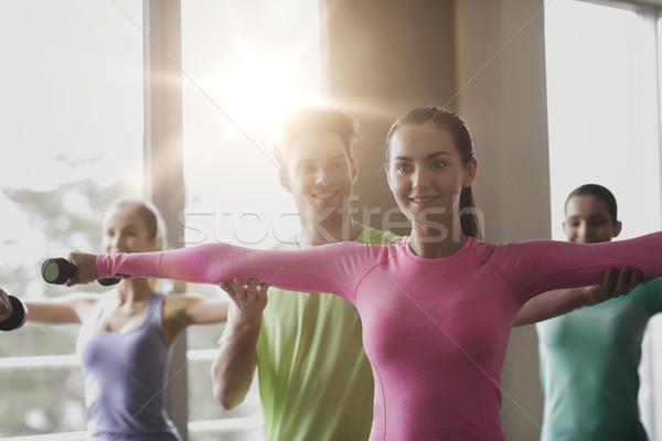 Stockfoto: Groep · glimlachend · mensen · die · uit · fitness