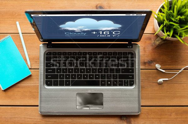 close up of laptop computer with weather forecast Stock photo © dolgachov