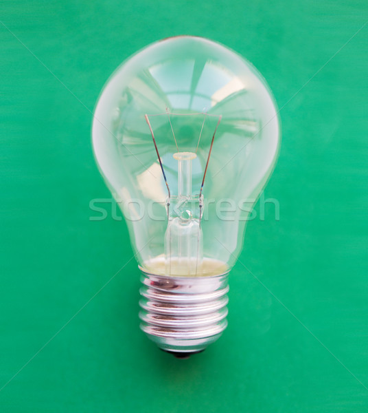 close up of bulb or incandescent lamp on green Stock photo © dolgachov