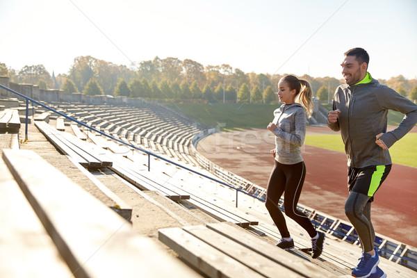 счастливым пару работает наверх стадион фитнес Сток-фото © dolgachov