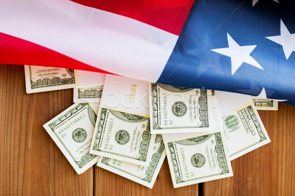 Amerikan bayrağı dolar nakit para bütçe Stok fotoğraf © dolgachov