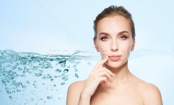 Stock photo: beautiful young woman showing her lips