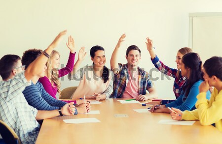 group of smiling students voting Stock photo © dolgachov