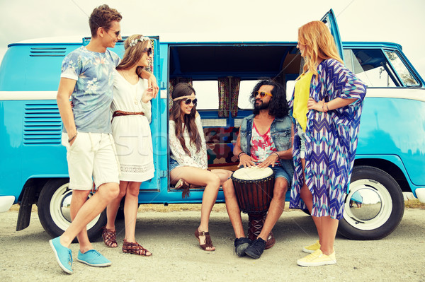 hippie friends with tom-tom playing music over car Stock photo © dolgachov