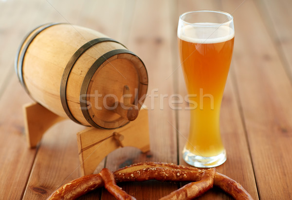 close up of beer glass, pretzel and wooden barrel Stock photo © dolgachov