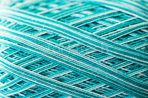 close up of turquoise knitting yarn ball Stock photo © dolgachov
