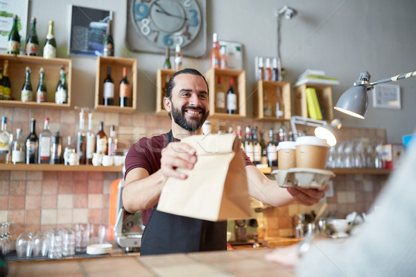 man or waiter serving customer at coffee shop Stock photo © dolgachov