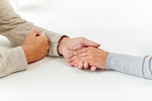Közelkép idős férfi fiatal nő kéz a kézben aggkor támogatás Stock fotó © dolgachov