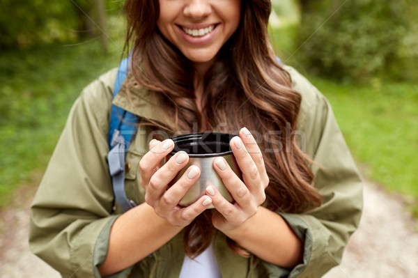 close up of woman with cup and backpack hiking Stock photo © dolgachov