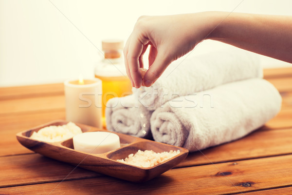 close up of hand with pink salt and bath stuff Stock photo © dolgachov
