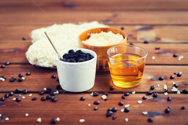 close up of coffee scrub in cup and honey on wood Stock photo © dolgachov