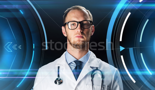 close up of doctor in white coat with stethoscope Stock photo © dolgachov