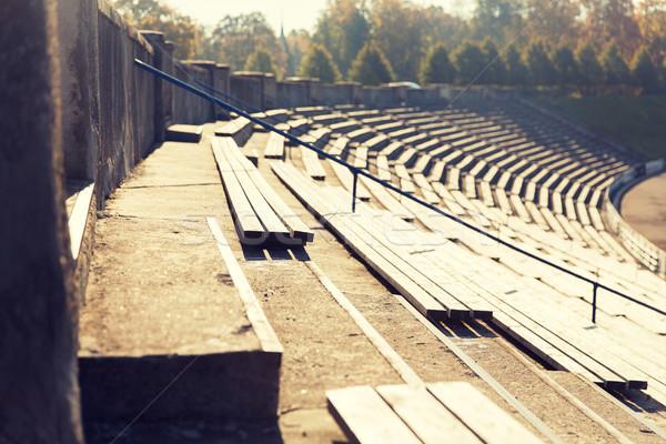 close up of bleachers with benches on stadium Stock photo © dolgachov
