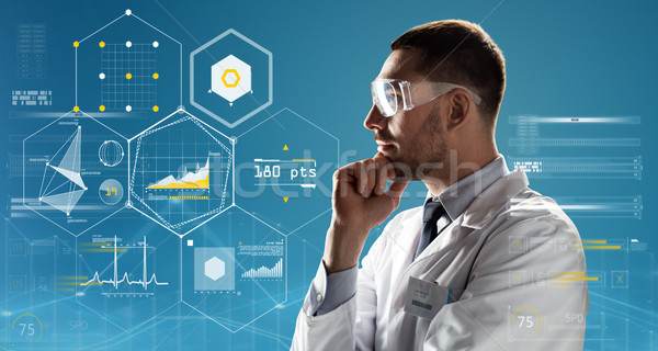 Stock photo: doctor or scientist in lab coat and safety glasses