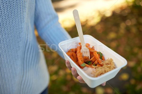 Mão prato batata doce fast-food Foto stock © dolgachov