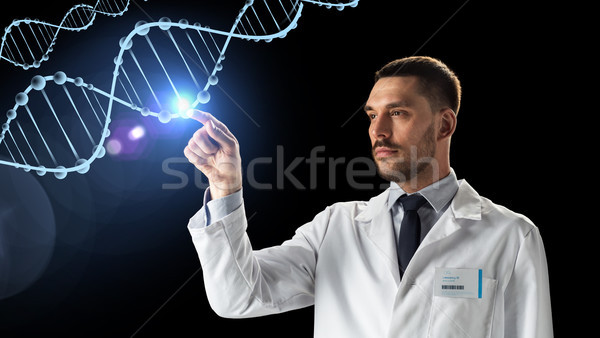 doctor or scientist in white coat with dna Stock photo © dolgachov