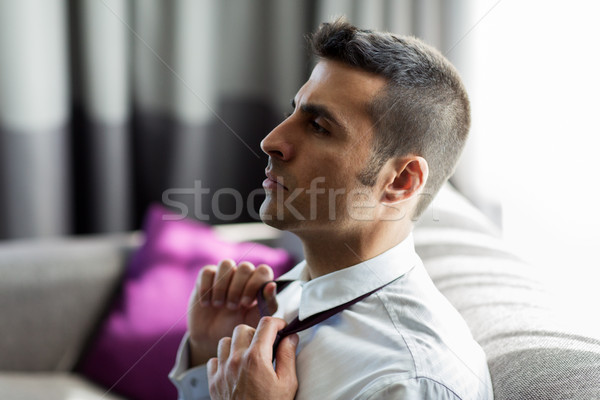 Empresário amarrar quarto de hotel pessoas Foto stock © dolgachov