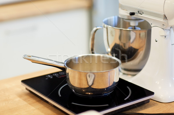 electric mixer and pot on stove at kitchen Stock photo © dolgachov