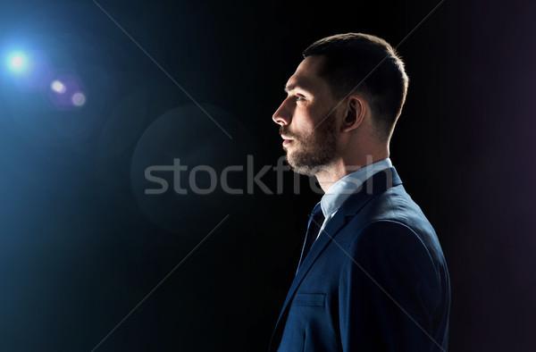 üzletember fekete becsillanás üzletemberek technológia öltöny Stock fotó © dolgachov