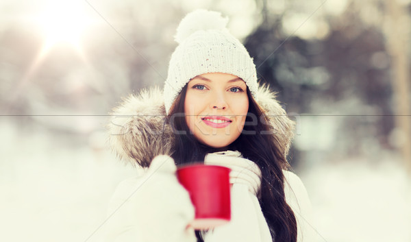 happy young woman with tea cup outdoors in winter Stock photo © dolgachov