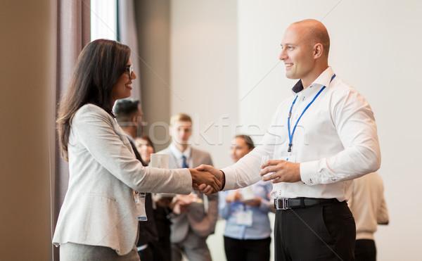 Kézfogás emberek üzlet konferencia együttműködés együttműködés Stock fotó © dolgachov