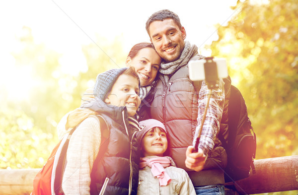 happy family with smartphone selfie stick in woods Stock photo © dolgachov