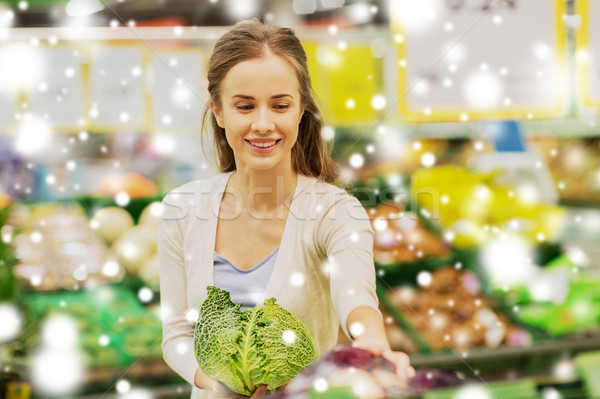 happy woman buying savoy at grocery store Stock photo © dolgachov