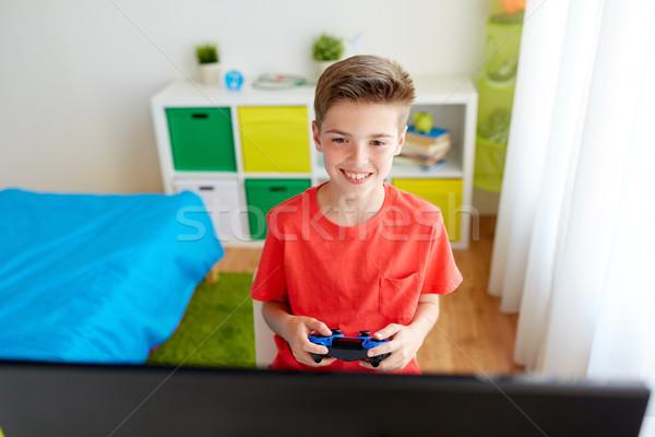 мальчика геймпад играет видеоигра компьютер Сток-фото © dolgachov