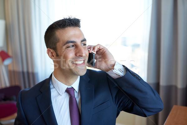 Empresário chamada quarto de hotel viagem de negócios pessoas Foto stock © dolgachov