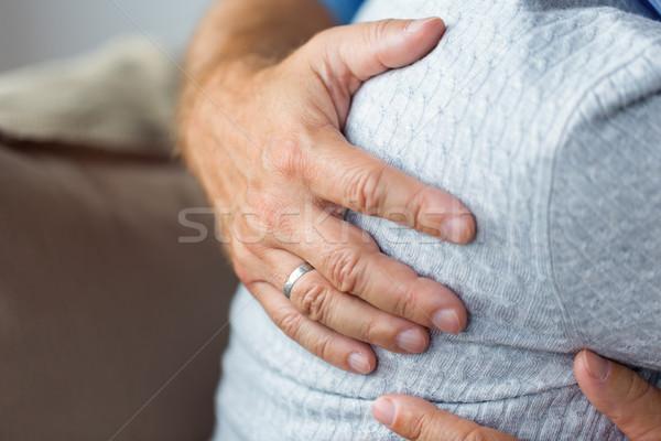 close up of married senior couple hugging Stock photo © dolgachov