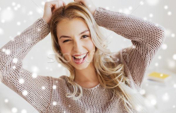 happy young woman or teenage girl showing tongue Stock photo © dolgachov