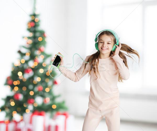 ストックフォト: 少女 · スマートフォン · ヘッドホン · クリスマス · 休日 · 子供