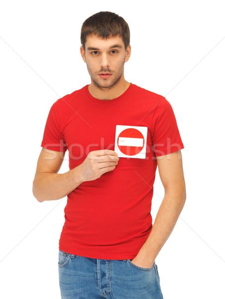 man holding no entry sign on the heart Stock photo © dolgachov