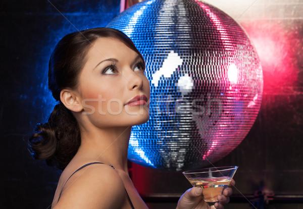 Kobieta koktajl disco ball piękna kobieta suknia wieczorowa strony Zdjęcia stock © dolgachov