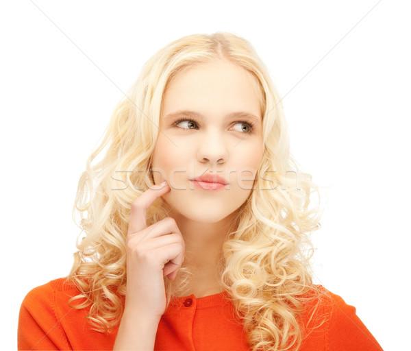 Ragazza pensare dito guancia foto teen Foto d'archivio © dolgachov