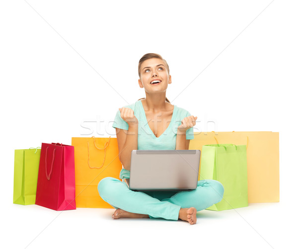 woman with laptop and shopping bags Stock photo © dolgachov