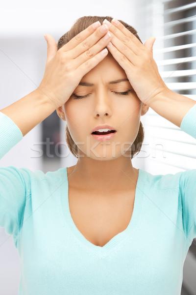 Boldogtalan nő tart fej kezek szomorú Stock fotó © dolgachov