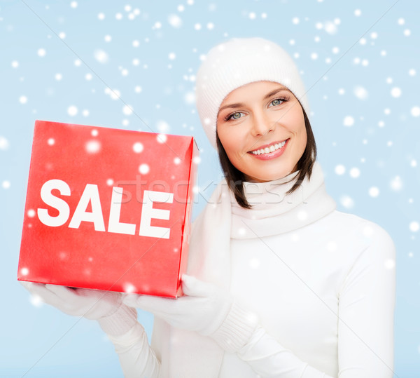 Stock photo: woman in winter clothes with red sale sign