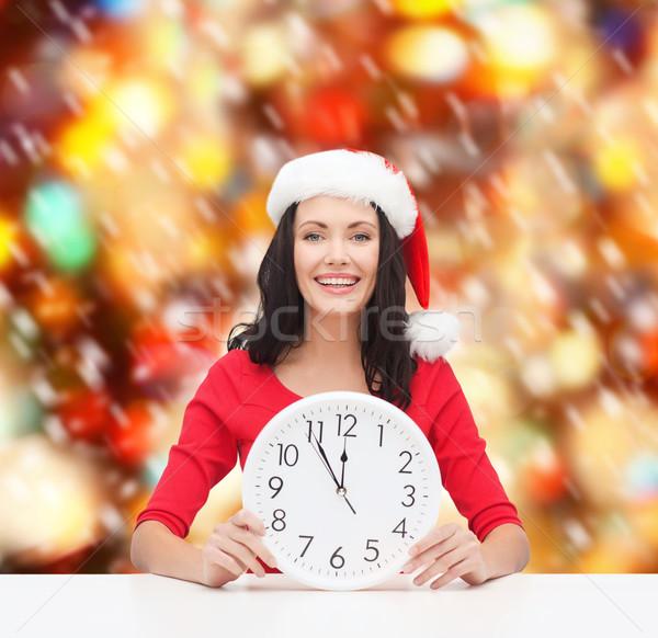 Nő mikulás segítő kalap óra mutat Stock fotó © dolgachov