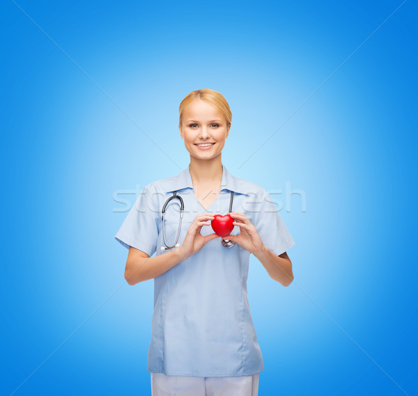 Stock photo: smiling female doctor or nurse with heart