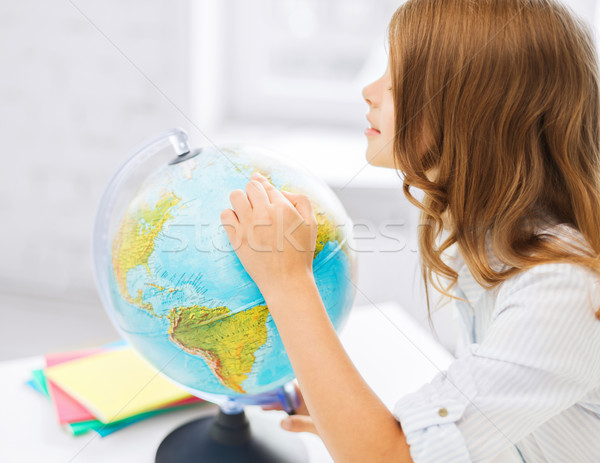 curious student girl with globe at school Stock photo © dolgachov