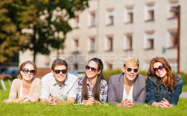 Stock photo: group of students or teenagers hanging out