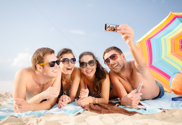 Stock photo: group of people taking picture with smartphone