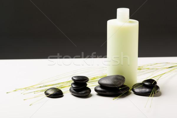 Sampon üveg masszázs kövek zöld növény Stock fotó © dolgachov