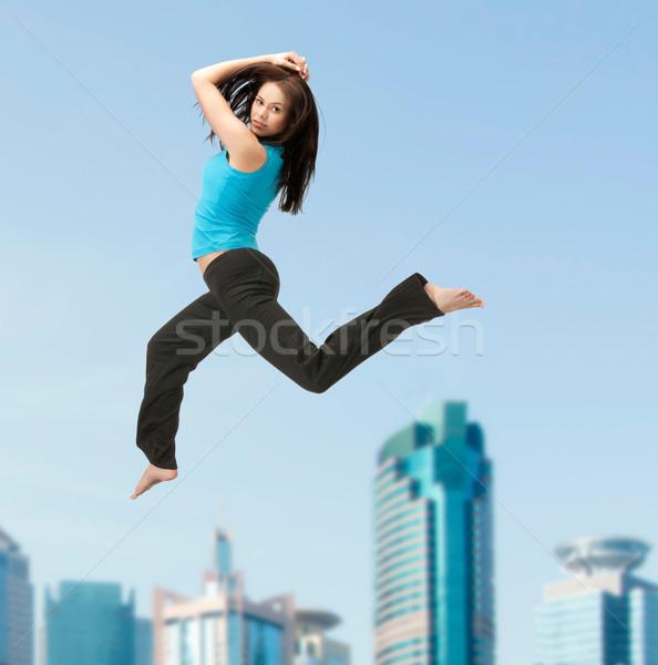 sporty woman jumping in sportswear Stock photo © dolgachov
