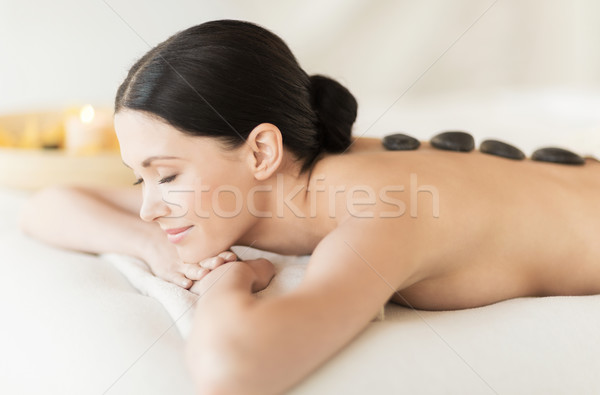 woman in spa with hot stones Stock photo © dolgachov
