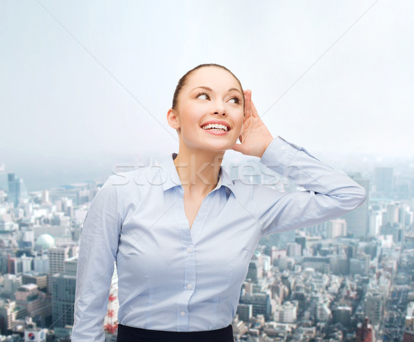 smiling businesswoman listening gossig Stock photo © dolgachov