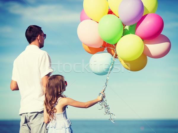 Apa lánygyermek színes léggömbök nyár ünnepek Stock fotó © dolgachov